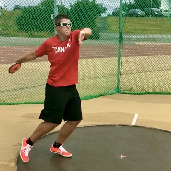 Paralympian Ness Murby throws a discus.