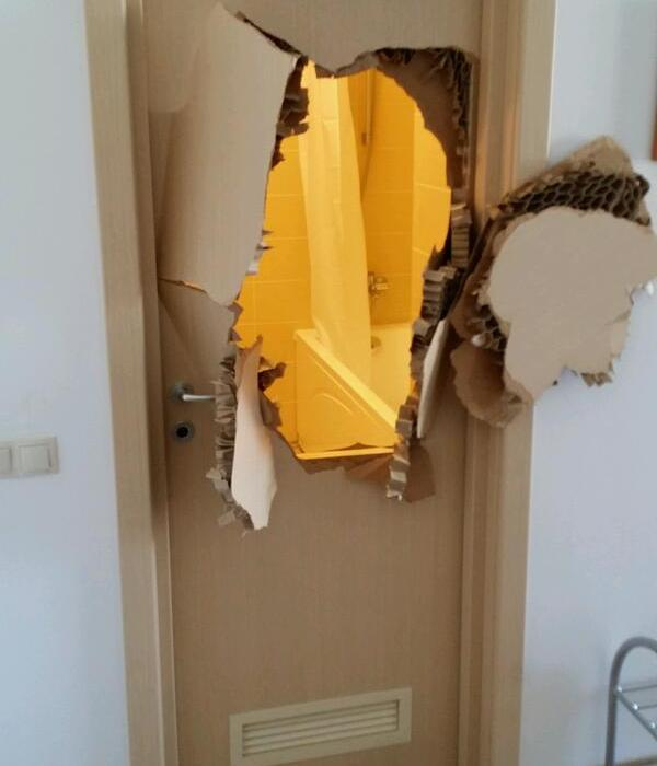 This is a picture of a door that has been broken through. This happened during the Sochi 2014 Olympics, when a door sealed shut, and a bobsledder couldn't open it. One of the many viral stories from these Olympics.