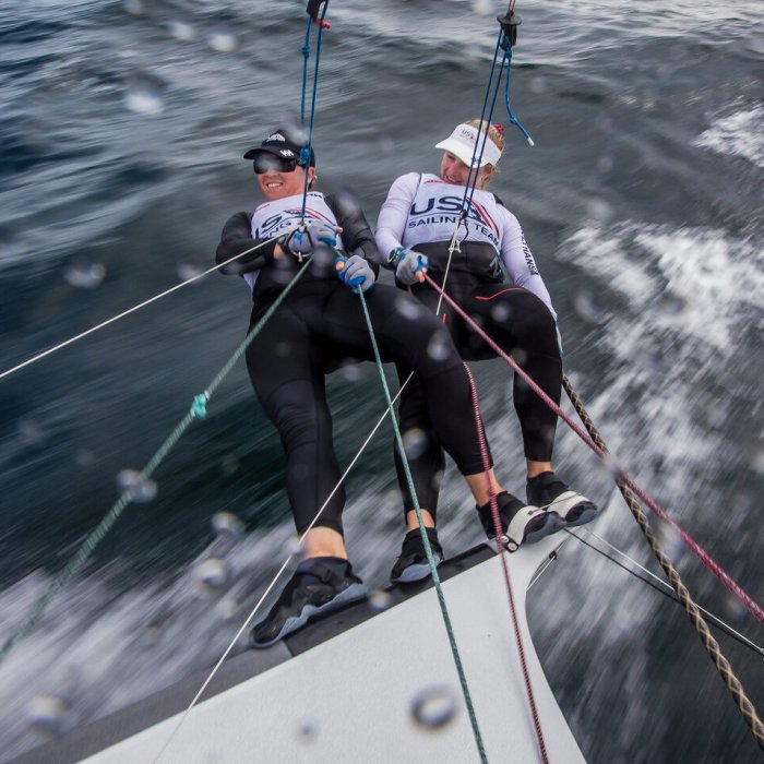 Photo of Maggie Shea and Stephanie Roble sailing on a 49erFX boat. The photo is taken from the mast, looking down on them. Photo courtesy of Roble/Shea Sailing.