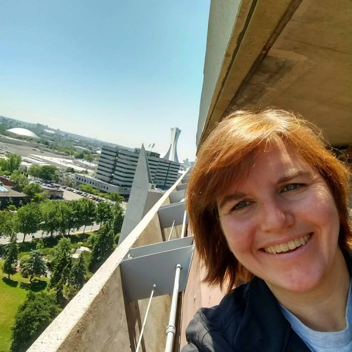 Jill on the balcony of the Olympic Village apartments from the Montreal 1976 Olympics. In the background is the tower of the Olympic Stadium.