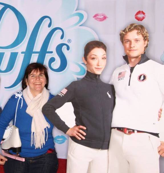 """""""Keep the Flame Alive"""" host Jill Jaracz with a cardboard cutout of US gold medalist ice dancers Meryl Davis and Charlie White at the 2014 US Figure Skating Championships."""