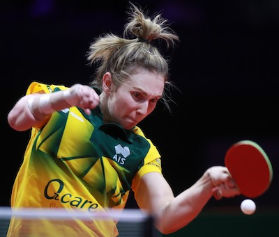 Table Tennis player Melissa, Australia's first athlete to compete at both the Olympics and Paralympics, prepares to hit a table tennis ball during competition.