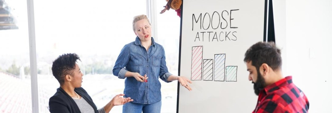 Lumberjack and Woman in Canadian Tuxedo discuss falling Moose attack stats