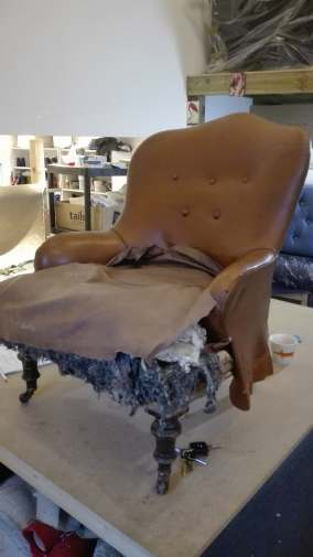 antique chair in need of full re-upholstery