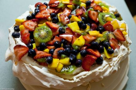 Pavlova. Often topped with whipped cream as well. No party is complete without a pav.