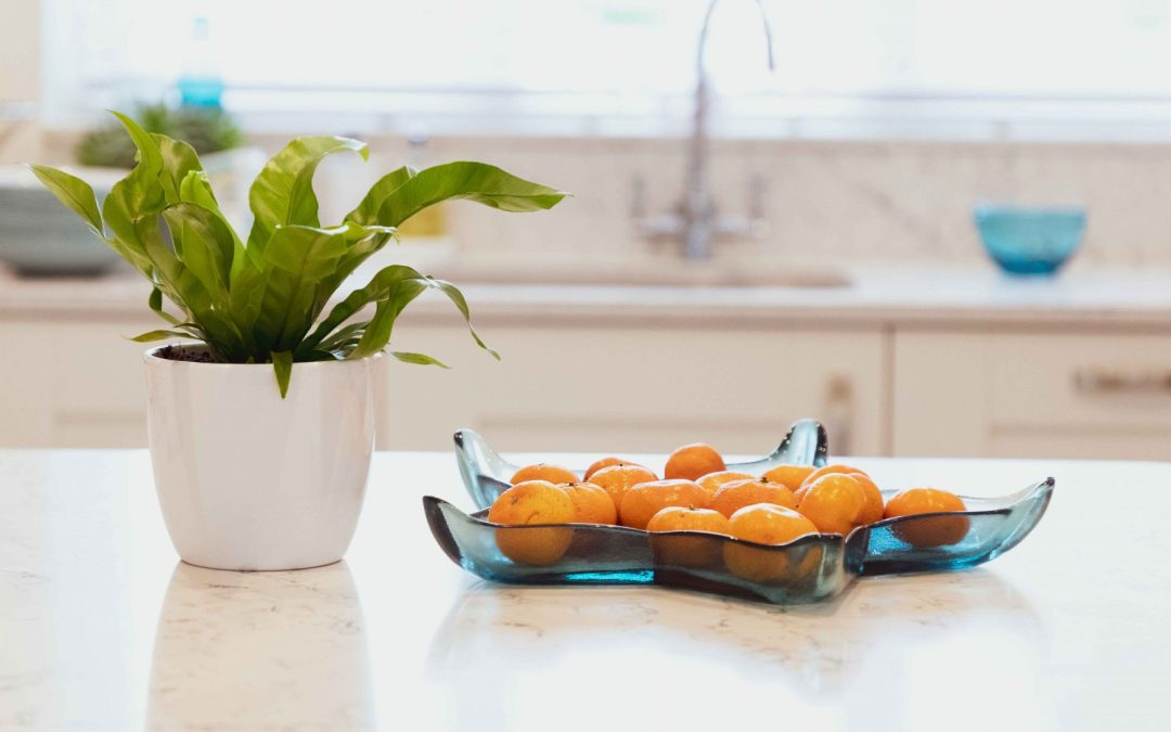 bowl of oranges and house plant in kitchen, decluttering