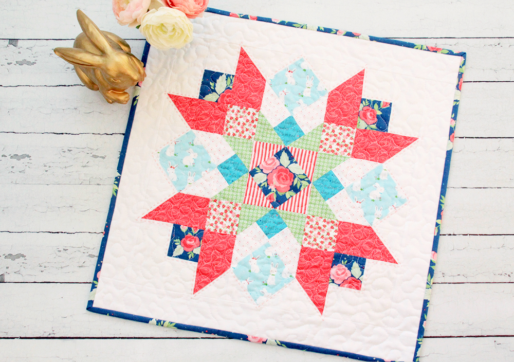 Winifred Rose Mini Quilt by popular US quilting blog, Flamingo Toes: image of a Winifred Rose Mini Quilt.