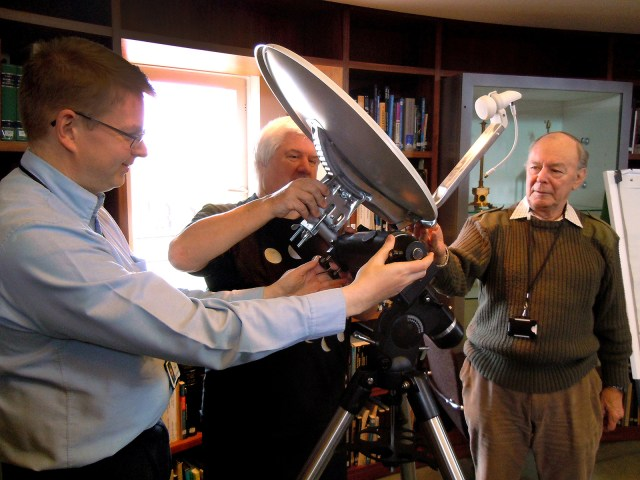 Mike, Adrian and Roger work out how to mount the satellite dish on the HEQ5 mount
