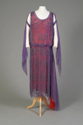 American, ca. 1925-1926. Purple silk chiffon, beaded with crystal in Chinese pattern and faced with dark pink silk chiffon, beaded sleeve bands.