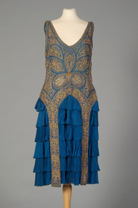 French, ca. 1926. With gold beading and panels, blue ruffled skirt.