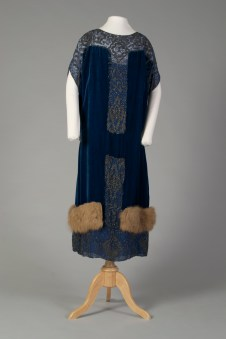American, ca. 1918. Navy blue chiffon and navy with fur at the hem.
