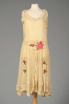 American, ca. 1925-1929. Silk georgette with silk flowers. The ruffles and full skirt make it look extra feminine.