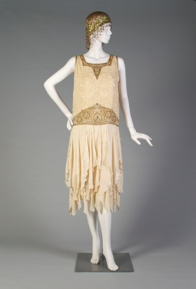 American, ca. 1925. Cream silk crepe with gold and ivory beading.