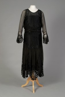 American, ca. 1921. Black chiffon and lace. The hem is already low again on this dress.