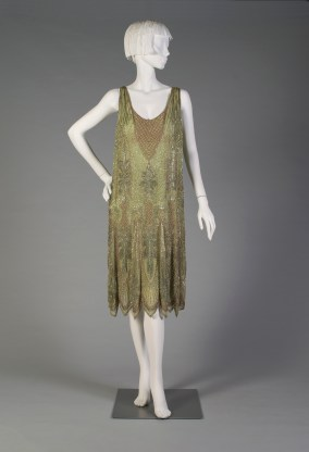 French, Paul Poiret, ca. 1925. Pale green silk chiffon, all over geometric design in silver, gold and clear beads.