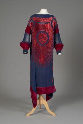 American, ca. 1921-1924. Navy crinkled silk chiffon with women geometric sunburst in red velvet.
