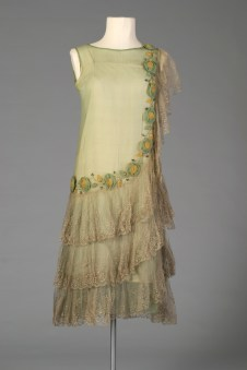 American probably, ca. 1929. Green silk chiffon with ruffles and silk flower appliques.