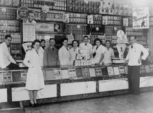 The staff of a small shop, by the counter