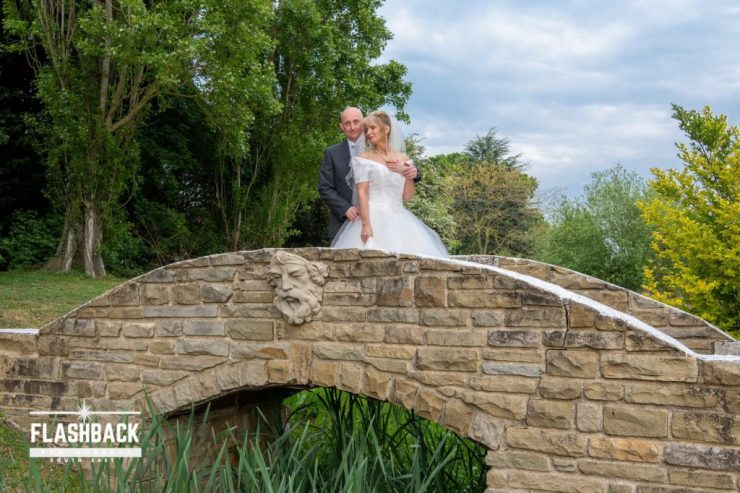 Essex Wedding Photography Bride and Groom posing on a bridge Kent Sussex Surrey Essex also located in our Essex Wedding Gallery