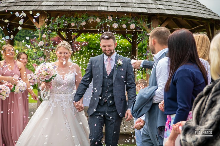 South East Wedding Gallery Kent Weddings - Bride and Groom confetti shot South East Wedding Gallery