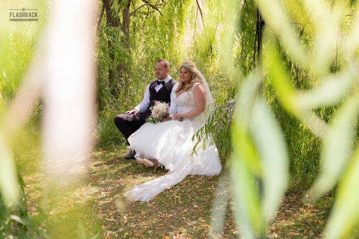 South East Wedding Gallery Kent Weddings - Bride and Groom sitting by a lake South East Wedding Gallery