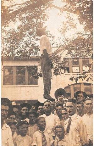 "Postcard depicting the lynching of Lige Daniels, Center, Texas, USA, August 3, 1920. The back reads, ""This was made in the court yard in Center, Texas. He is a 16 year old Black boy. He killed Earl's grandma. She was Florence's mother. Give this to Bud. From Aunt Myrtle."""