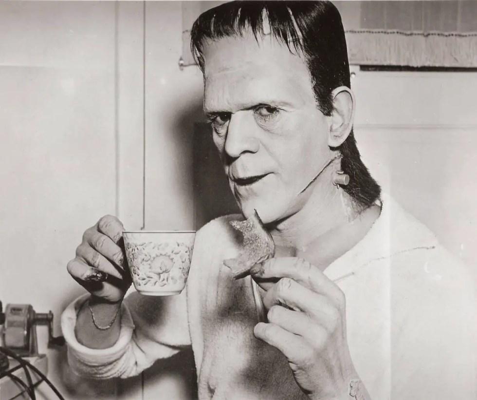 Boris Karloff having a nice cup of tea and a piece of toast between shots of Frankenstein, released in 1931.