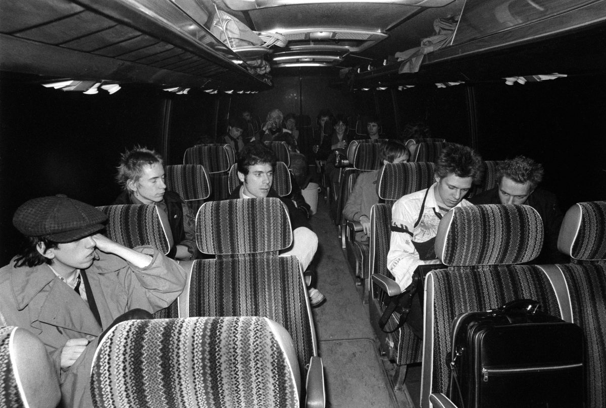 Sex Pistols and The Clash - Johnny Rotten (left), Paul Simonon, Joe Strummer (right), Mick Jones (front) Anarchy Tour bus. Dec 1976