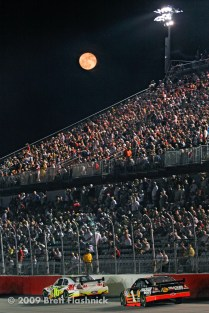 As a full moon rises over the grandstands of Darlington Raceway, in Darlington, S.C., NASCAR Sprint Cup Series drivers, Greg Biffle, front, and Martin Truex, Jr., race down the front straightaway during the 60th running of the Southern 500, Saturday, May 9, 2009. (© 2009 Brett Flashnick/flashnick | visuals)