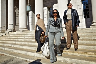 Yamma Noyola Brown Lumar, left, Deanna Brown Thomas, center and Venisha Brown, right, daughters of James Brown, leave the South Carolina Supreme Court after justices listened to arguments by lawyers for family and trustees of the estate of James Brown, in Columbia, S.C., Tuesday, Nov. 1, 2011. The trustees are suing over a settlement pushed through by then Attorney General, Henry McMaster, which gave about half of Brown's assets to a trust, a quarter to Brown's widow and young son, and the rest to his adult children. (AP Photo/Brett Flashnick)