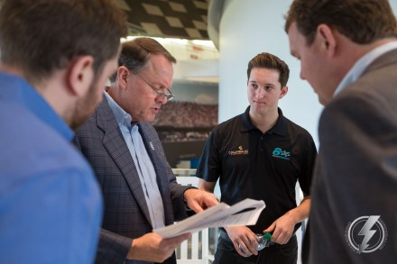 Winston Kelley, left, goes over the Columbia, SC sponsorship announcement program with Jordan Anderson, center, and Darlington Raceway President Chip Wile, right, at the NASCAR Hall of Fame in Charlotte, NC.