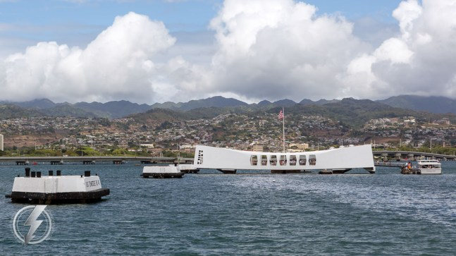 The USS Arizona Memorial, at Pearl Harbor in Honolulu, Hawaii, marks the resting place of 1,102 of the 1,177 sailors and Marines killed on USS Arizona (BB-39) during the Japanese surprise attack on Pearl Harbor on December 7, 1941. Built in 1962, it straddles the sunken hull of the battleship without touching it and is visited by more than two million people annually. © Copyright 2016, Brett Flashnick - All Rights Reserved.