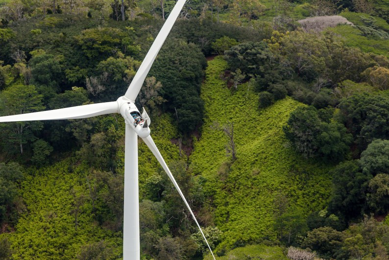 Workers service a large wind turbine on the Kawailoa Wind Farm near the town of Haleiwa on the north shore of the Hawaiian Island of O'ahu.