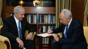 President Shimon Peres signs the formal document charging Prime Minister Benjamin Netanyahu with forming the next government, at a ceremony at the President's Residence, February 02, 2013. (Photo credit: Kobi Gideon / GPO/FLASH90/Times of Israel)