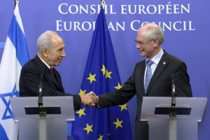 Israel's President Shimon Peres (L) thanks European Council President Hermen Van Rompuy during a joined news conference after a meeting at the EU Council. (photo credit: Reuters/Eric Vidal)