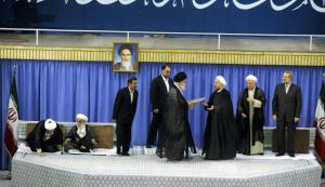 Iranian supreme leader Ayatollah Ali Khamenei officially endorsing cleric Hassan Rohani, August 3, 2013. (Photo: AFP/Haaretz)