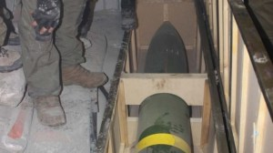 IDF soldiers inspect a missile found on board Klos-C in a commando operation Wednesday morning. The military says the ship was carrying an Iranian arms shipment headed for Gaza (Photo credit: IDF/Times of Israel)