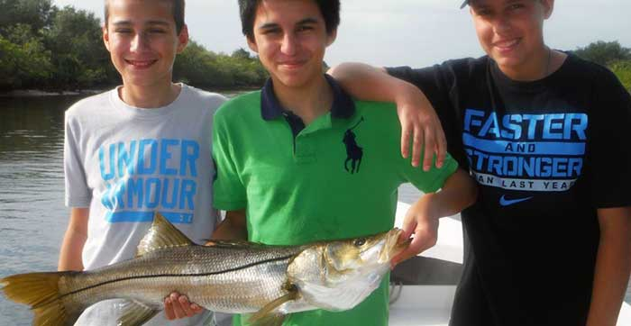 tampa family fishing charters group of kids with snook
