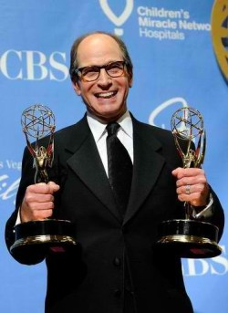 """Harry Friedman holds two of the 14 Emmys he received during a decades-long career producing """"Jeopardy"""" and """"Wheel of Fortune."""""""