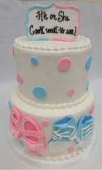 two tier baby booty gender reveal cake