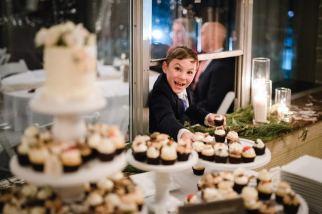 wedding dessert display with child grabbing cupcake!