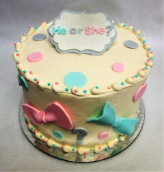 Gender reveal bows and bowtie polka dot cake