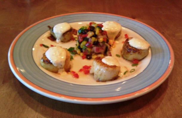 Image of a plate of blackened sea scallops with dijon tartar dressing