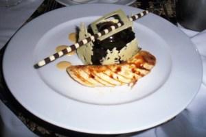 Image of chocolate cake with sliced caramelized banana and chocolate straw