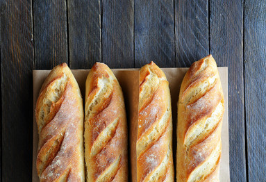 four crunchy french baguette on boards