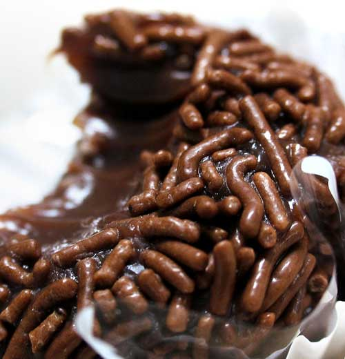 "Brigadeiro was created by the wife of Brigadeiro (Brigadier) Eduardo Gomes, who was a Presidential candidate in Brazil in the 1940s. His wife would cook the candies and serve them during their fundraising events. The guests loved the treat and soon enough people started asking: ""Have you tried the Brigadeiro's candy? Where is the Bridagier's candy?"" And that is where the name Brigadeiro comes from."