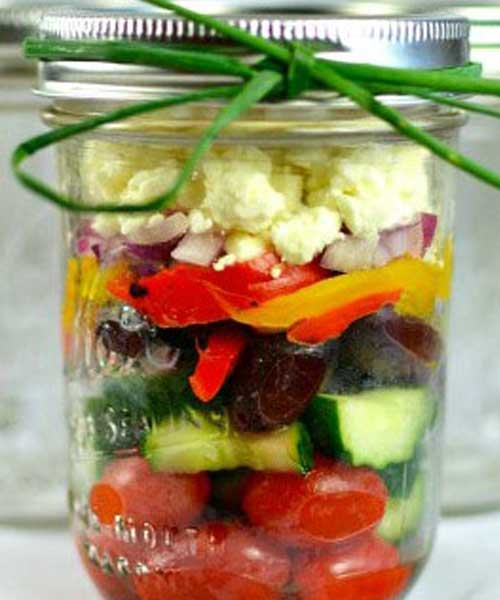 Liven up that same old salad by layering those fresh ingredients into a Mason jar! Perfect for a party or grab and go for lunch, these Chunky Mediterranean Mason Jar Salads are jammed packed with flavor. Grab, go and enjoy! #salad