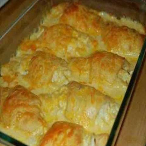 A tasty and hearty Chicken Crescent Roll Casserole to wrap up the winter. Chicken hidden underneath pillows of crescent rolls. Feed your crowd without breaking the bank.
