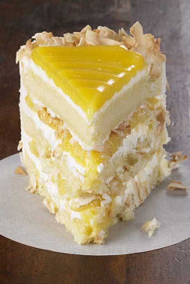 Tangy lemon filling between layers of tender white cake. Top it all off with a rich coconut-cream cheese frosting. Some people think that this Lemon Coconut Cake is the best cake they've ever eaten. #lemon #cake #dessert #baking