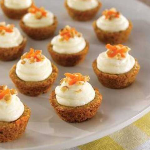 Pile on the frosting! Our homemade, cream cheese icing makes these Mini Carrot Cake Cups irresistible!
